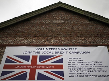 A banner encouraging people to support a local Brexit campaign hangs on the side of a building in Altrincham, Britain. Reuters