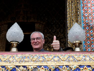 Leicester Citys manager Claudio Ranieri visits the Emerald Buddha temple in Bangkok. Reuters