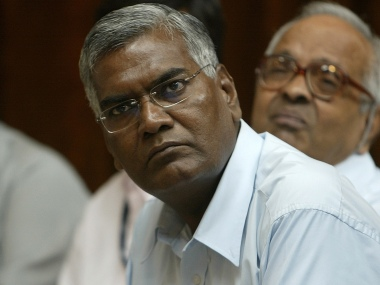 "Communist Party of India Leader D Raja (L) listens to CPI(M) General Secretary Prakash Karat speak during a conference on ""Indo-US Nuclear Deal- Implications for Democracy and Sovereignty"" in New Delhi, 13 September 2007.  In a clear message that it will pull the rug if the government went ahead with the Indo-US nuclear accord, the CPI (M)  bluntly told the Congress-led coalition that it would not be there to help it seal the deal.  Karat made this clear after strongly opposing the 123 agreement and India's burgeoning strategic and military partnership with the US.   AFP PHOTO/ Prakash SINGH / AFP PHOTO / PRAKASH SINGH"