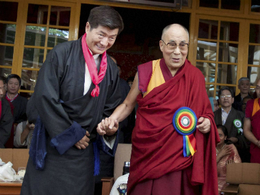 Dharamshala: Tibetan Spiritual Leader, Dalai Lama (R) with the newly elected Tibetan Prime Minister ( Sikyong) , Lobsang Sangay (L) during the swearing- in ceremony in Mcleodganj, Dharamshala on Friday.