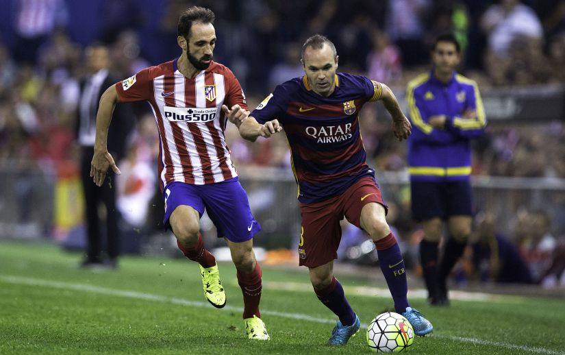 Spanish players Andres Iniesta and Juanfran during a La Liga match. Getty Images