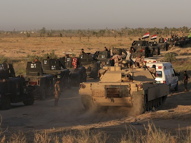 Iraqi military forces prepare for an offensive into Fallujah to retake the city from Islamic State militants. AP