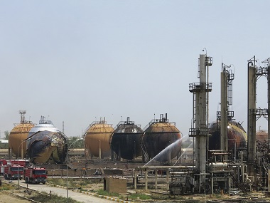 Iraqi firefighters try to extinguish a fire at a natural gas plant in Taji on Sunday. AP