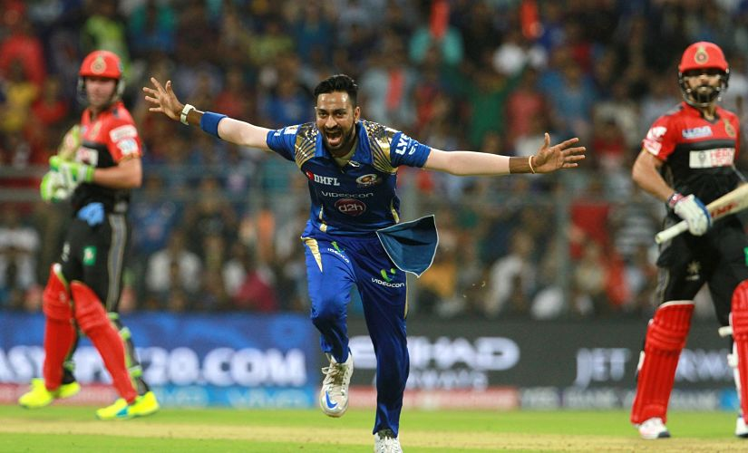 Mumbai Indians player Krunal Pandya celebrates the wicket of Virat Kohli. SportzPics