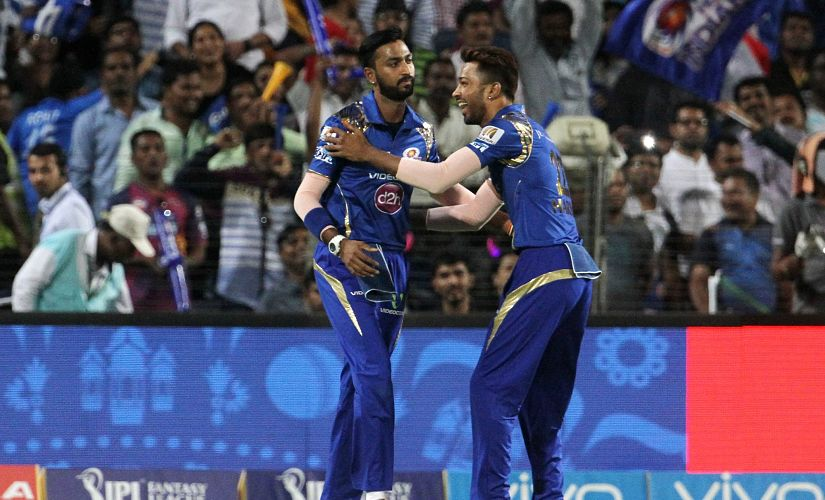 Mumbai Indians player Krunal Pandya and Hardik Pandya celebrate a wicket during IPL 9. SportzPics