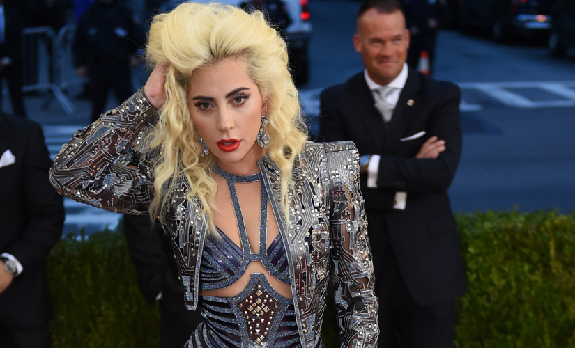 Lady Gaga, thinking about when she can kick off her shoes