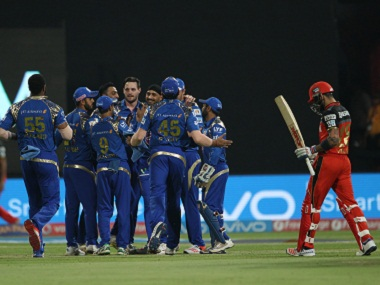 Mumbai Indians players celebrate the wicket of RCB captain Virat Kohli. BCCI