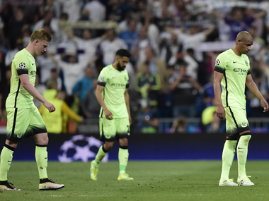 Manchester City players after their UCL defeat. AFP