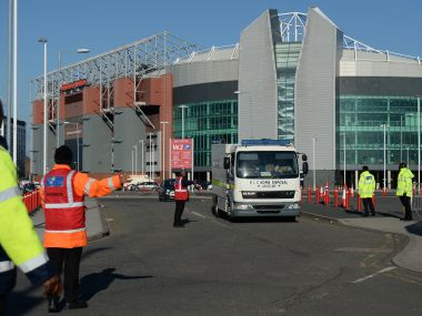 Event staff guide a British Army Bomb Disposal Unit truck as it leaves Old Trafford stadium. AFP