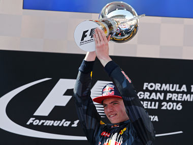 Max Verstappen holds his trophy on the podium after winning the Spanish Formula One Grand Prix. AP