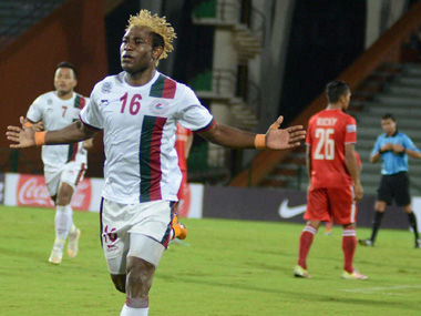 Mohan Bagan player Sony Norde celebrates after scoring 1st goal  against Aizwal FC. PTI