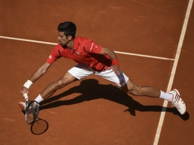 Novak Djokovic returns a ball at the Madrid Open. AFP