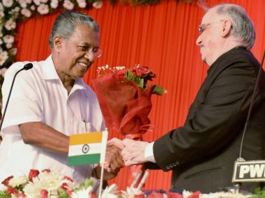 Kerala Governor Justice (retd) P Sathasivam greeting newly sworn-in Chief Minister Pinarayi Vijayan. PTI