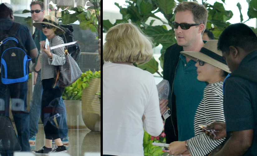 (L) Preity and Gene at the airport; (R) their family, who the couple is travelling with. Image by Sachin Gokhale