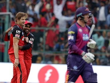 Royal Challengers Bangalore players celebrate a wicket against Rising Pune Supergiants. BCCI
