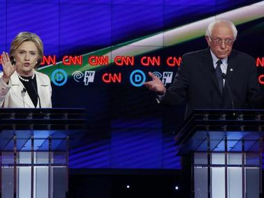 File photo of Hillary Clinton (L) and Bernie Sanders at a debate hosted by CNN and New York One. Reuters