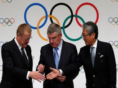 IOC President Thomas Bach with IOC Vice President John Coates (L) and Japanese Olympic Committee President Tsunekazu Takeda REUTERS