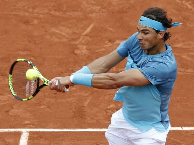 Spain's Rafael Nadal returns in his first round match of the French Open. AP