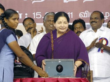 A file photo of Tamil Nadu CM J Jayalalithaa giving away free laptop to a student. AFP