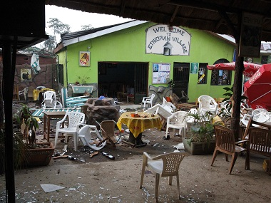 "Damaged chairs and tables lie amongst the debris strewn after a bomb attack outside the ""Ethiopian Village"" restaurant in Kampala. File photo AP"