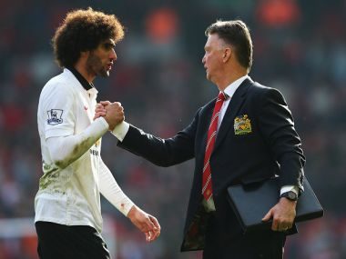 Louis van Gaal, manager of Manchester United with Marouane Fellaini. Getty