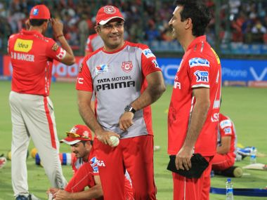 Virender Sehwag of Kings XI Punjab with team players. BCCI