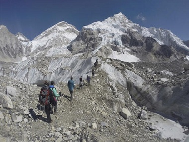 International trekkers pass through a glacier at the Mount Everest base camp, Nepal. AP