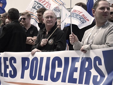 "Policemen demonstrate behind a banner reading ""Angry policemen"" during a protest on Wednesday in front of a police station in the French eastern city of Strasbourg. AFP"