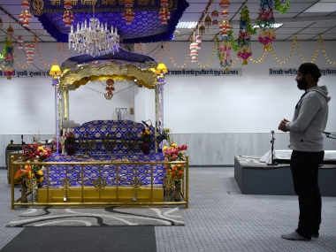 "A member of the Sikh community prays the Sikh temple, damaged by an explosion at the weekend can be seen in Essen, Western Germany on April 21, 2016. German police arrested two teenagers with Islamist backgrounds on April 21, 2016 over an explosion that wounded three people at a Sikh temple, labelling it a ""terrorist attack"". / AFP PHOTO / PATRIK STOLLARZ"
