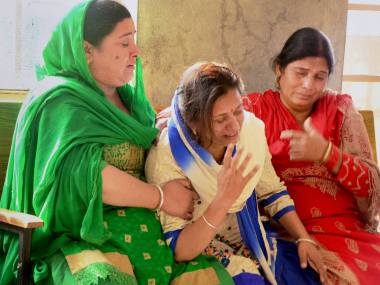 Jogindernagar: Women mourn the death of a relative who died in a bus accident at Gallu near Jogindernagar on Saturday night. PTI
