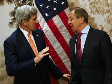 US Secretary of State John Kerry and Russian Foreign Minister Sergey Lavrov arrive for a meeting in Vienna on Monday. AP
