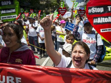 May Day marchers take to the streets of Los Angeles, calling for immigrant and worker rights. AP