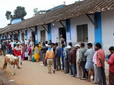 Nilgiris: People wait to cast votes at a polling station during Assembly elections at Ooty in Nilgiris on Monday. PTI