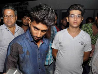 Youths who were beaten up allegedly by JD(U) MLC Manorama Yadav's son for overtaking his car in Bihar's Gaya district on Saturday night. PTI