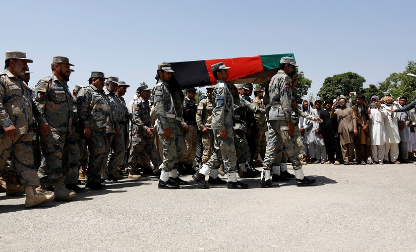 Afghan security forces carry the coffin of an Afghan soldier, who was killed during gun fighting between Afghan border forces and Pakistani forces at Torkham. Reuters