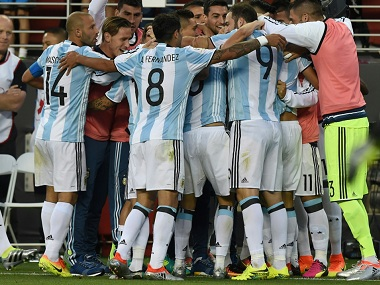 Argentinina players celebrate their winning goal against Chile. AFP