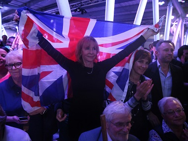 A Brexit supporter holds a Union Flag at a Vote Leave rally in London. Reuters