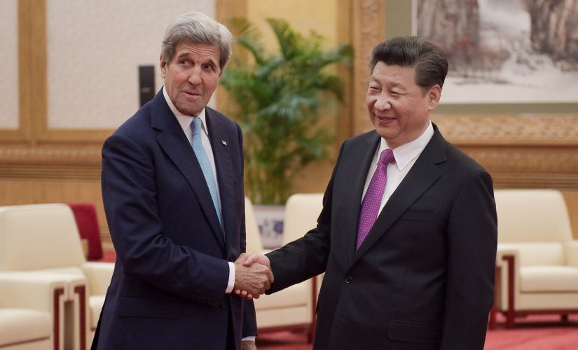 Chinese President Xi Jinping shakes hands with US Secretary of State John Kerry prior to a meeting at the Great Hall of the People in Beijing on Tuesday. AP
