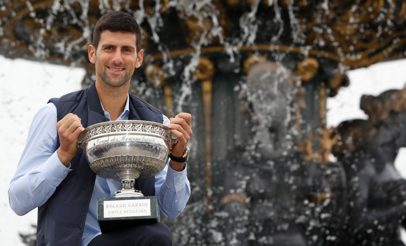 Novak Djokovic poses with the French Open trophy at Place de la Concorde. Reuters