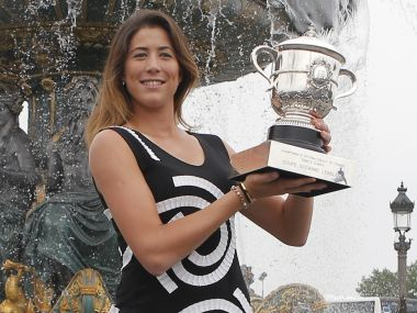 Garbine Muguruza poses with the French Open trophy at Concorde Plaza in Paris. AP