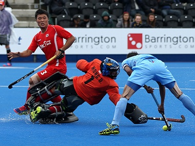 India's SV Sunil rounds the Korean goalkeeper to score the team's first goal. AP