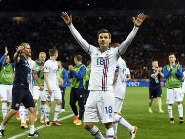 Iceland's midfielder Theodor Bjarnason celebrates with teammates after the team's draw to Portugal. AFP