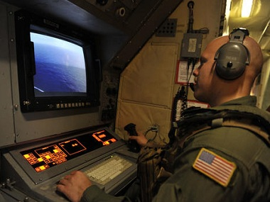 U.S. Navy AWO2 Brandon Fregeau looks at a monitor searching the area in the Mediterranean Sea where the Egyptair flight 804 went missing. AP.