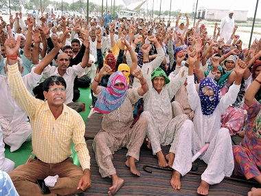 Jat community members during their agitation for reservation in Rohtak. AP.