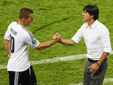 Podolski and Loew shake hands. Reuters