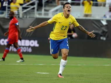 Brazil's Philippe Coutinho celebrates after scoring a goal against Haiti. AP