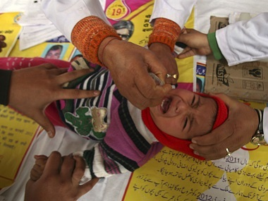 A child receives polio drops during a polio eradication programme in Jammu. File photo Reuters