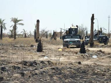 A file image of Iraqi security forces driving through Fallujah, Iraq. Reuters