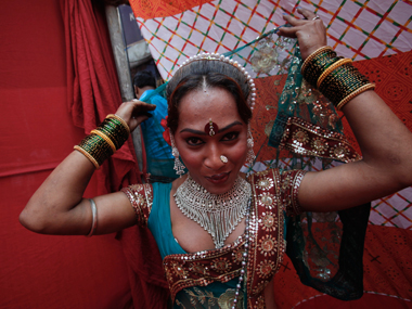 A sex worker, Raksha, readies for a performance during an event organised in Kamathipura by an NGO. Image from Reuters