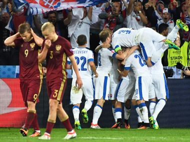 Slovakia players celebrate after scoring their second goal against Russia. AP